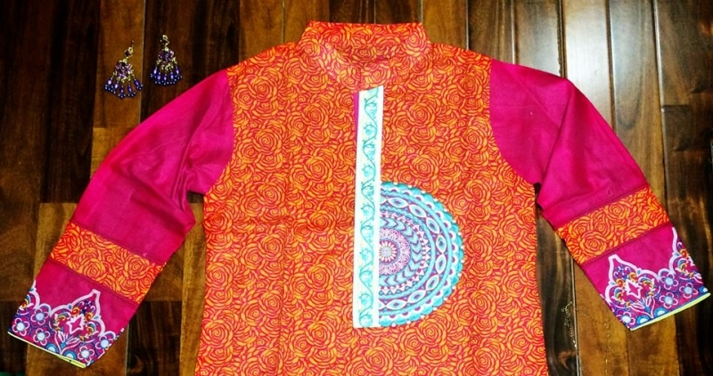 Eye-catching Straight shirt with embroidered neck line.