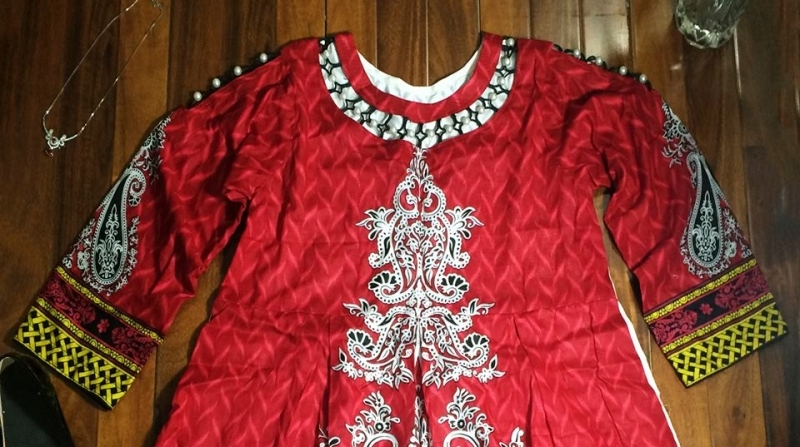 A-line top with beautifully designed neck, ornaments on sleeves