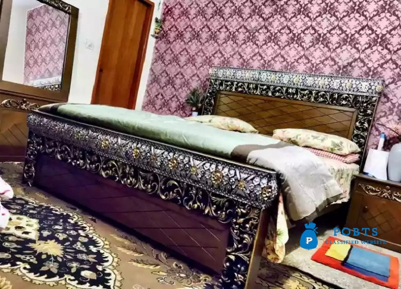 Fancy king size double bed with side tables and Dressing