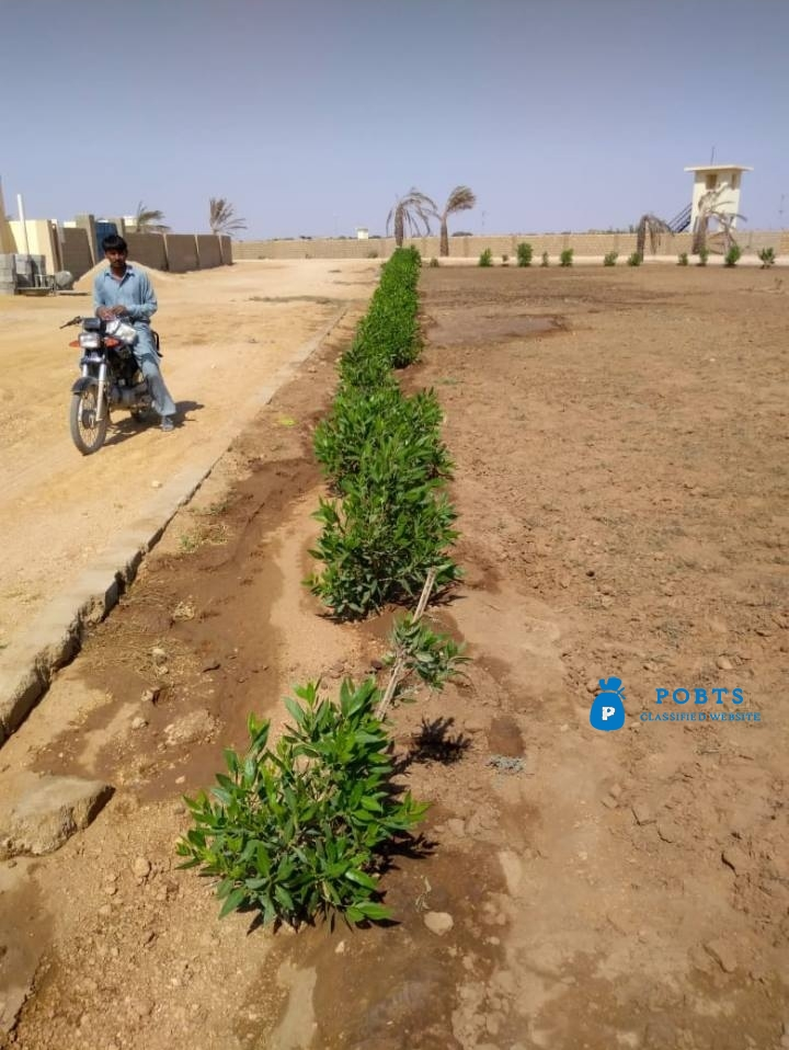 Farm Houses Plots Land on installments in a Gated Secured Project Super Highway