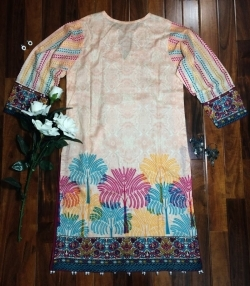 Colorful top with embroidered neck line. Beautiful tussles at the bottom